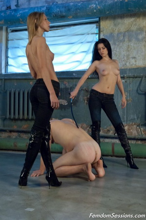 Two dominant ladies breaking in a new slave in a damn spooky old building